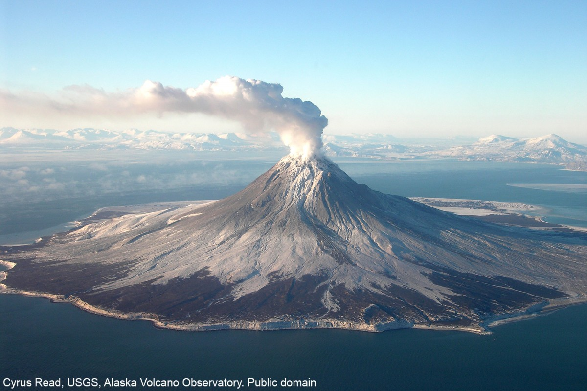 A gas plume arising from Augustine Volcano during it's eruptive phase 2005-06. This photo was taken during  a FLIR/maintenance flight on January 24, 2006. Cyrus Read, USGS, Alaska Volcano Observatory. Public domain