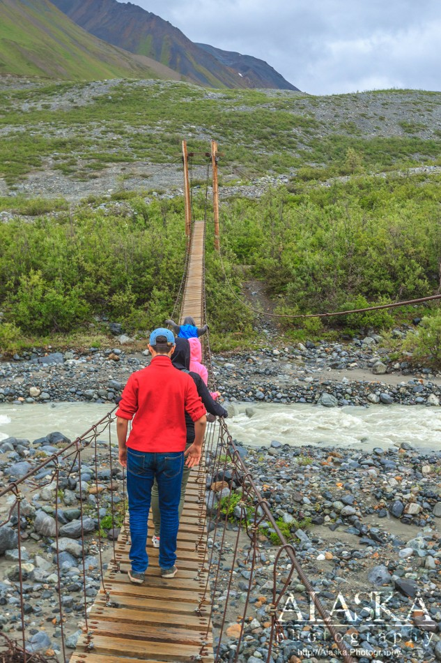 Crossing College Creek on the Gulkana Glacier Trail bridge.