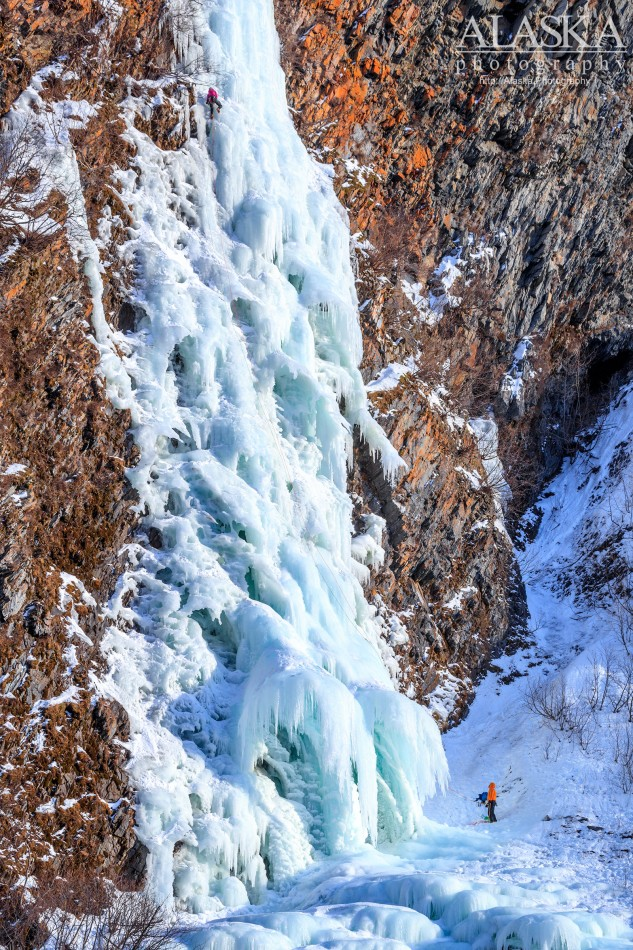 A pair of ice climbers climb Hung Jury, Keystone Canyon, Valdez.
