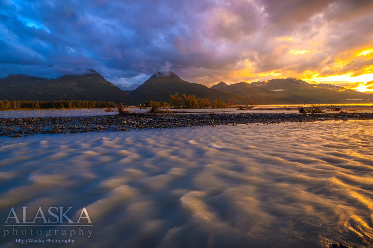 Sunset on Valdez Glacier Stream with Port Valdez and Sugarloaf Mountain in the background.