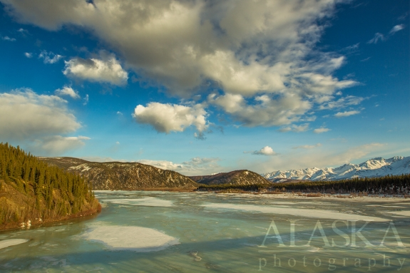 Looking down the Johnson River as it merges with the Tanana River, with the Alaska Range in the background.