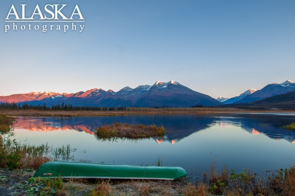 A canoe sits along the shore at the end of Robe Lake.