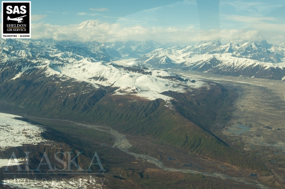 Kanikula Creek on one side with the moraines of Tokositna Glacier on the other, all beneath Denali (Mt McKinley).