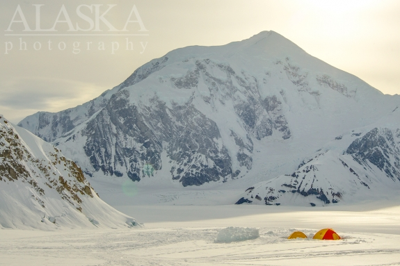 Looking out from base camp along the Southeast Fork Kahiltna Glacier, across the Kahiltna Glacier, at Mount Foraker.