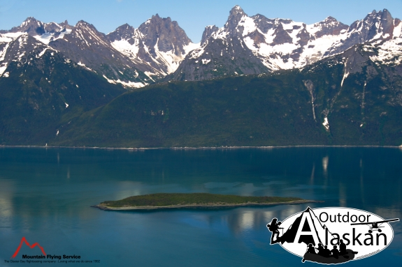 Talsani Island sits in Lynn Canal, and Yeldaglga Creek feeds Lynn Canal on the left.