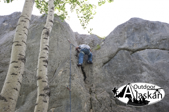Climbing up the middle route on West Grapefruit Rocks.
