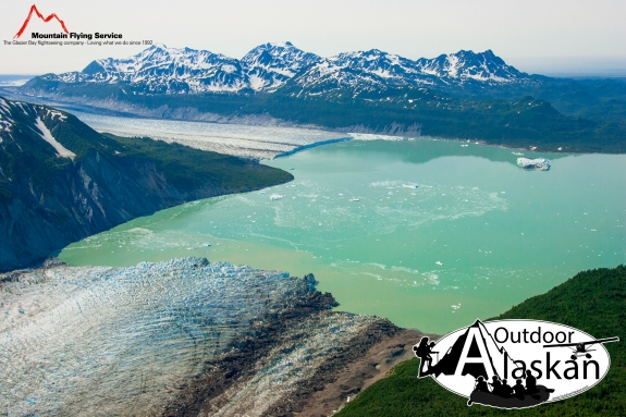 Alsek Glacier flows up from the bottom to meet Grand Plateau Glacier in Alsek Lake, with Deception Hills in the background. July 2009.