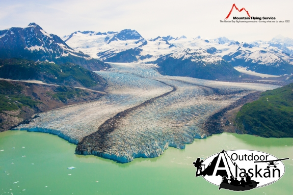 Alsek Glacier empties into Lake Alsek. Mount Fairweather peaks out on the right of the frame. Taken July 2009.