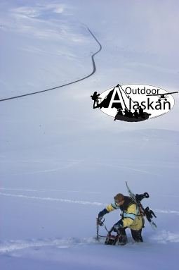 Haines local Jason Allgood stops for a minute while climbing Glave Peak to snowboard down it.