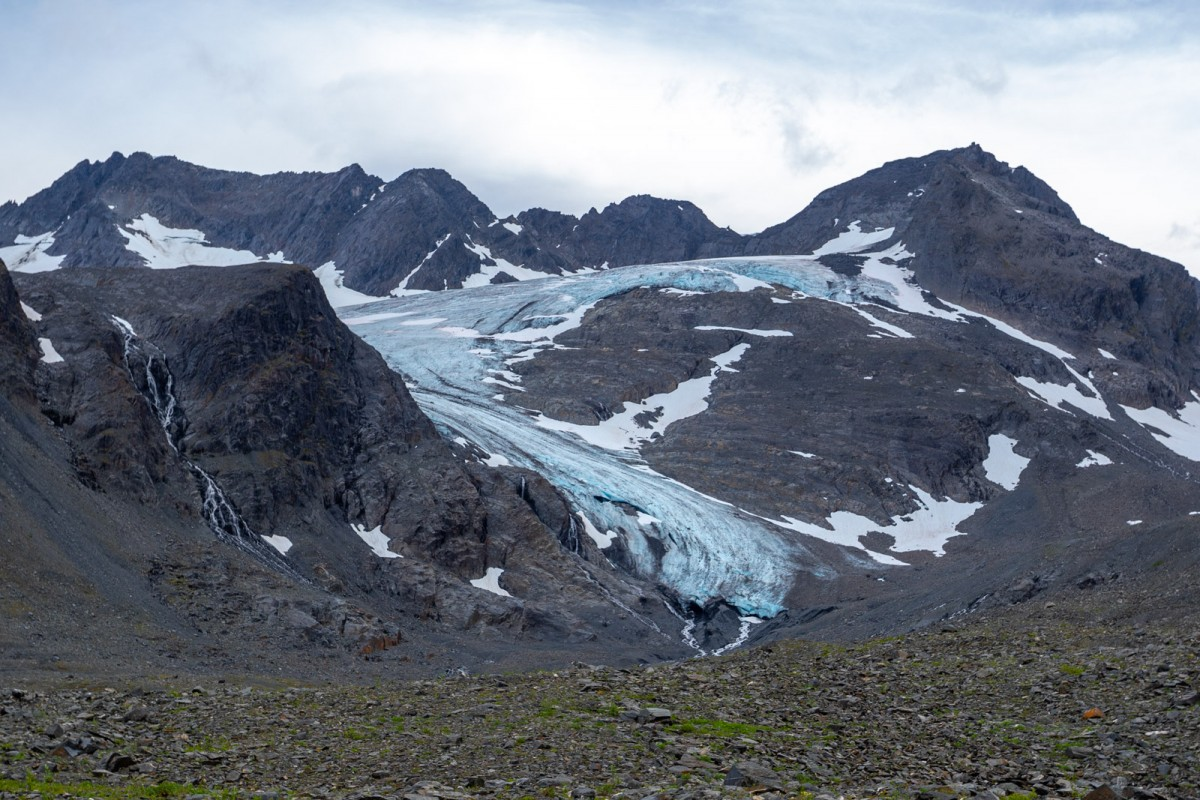 Hike through glacier carved valleys and underneath the retreating glaciers.