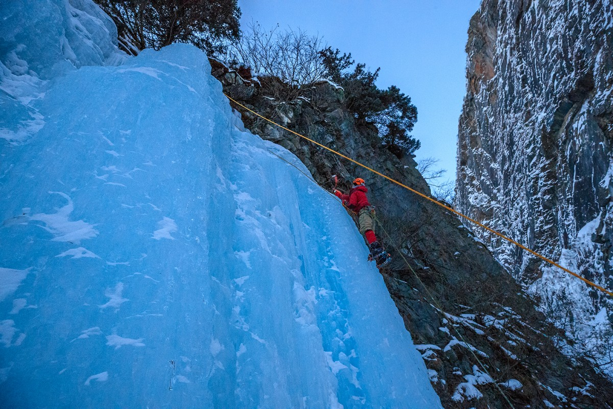 Climbing the blue ice in Keystone Canyon with the Valdez Winter Ice Climbing Tour.