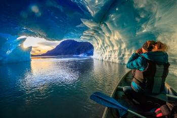 Watching the sunset from inside the cave of an iceberg.