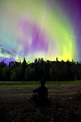 Watching the northern lights one August night from along the Alaska Highway on our guided tour.