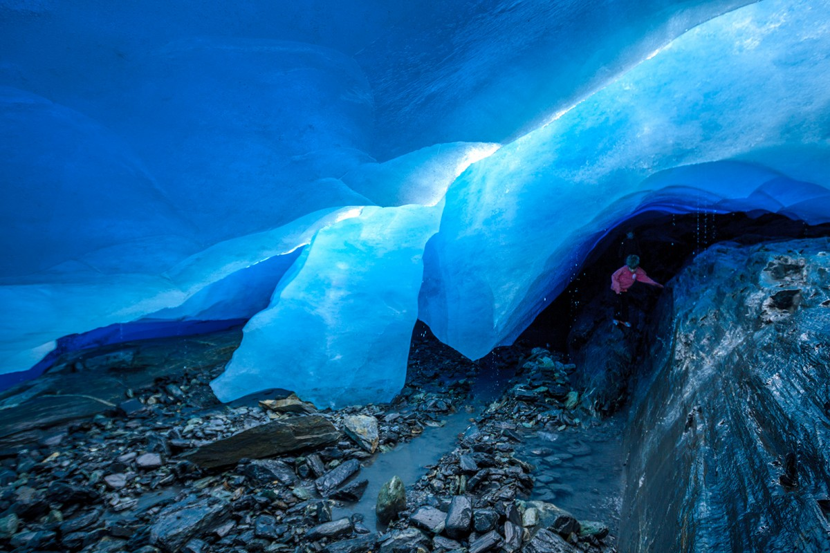 Kids climb around beneath Worthington Glacier.